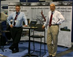 Andreas Delhusen, CEO of DHF Airport Systems (left), and Jan Eric Larsson, CEO of GoalArt, at the GSE International Expo in Las Vegas, May 2004.
